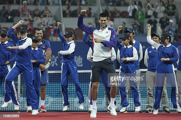 Novak Djokovic of Serbia dances 'Gangnam Style' after defeqating Jo-Wilfried Tsonga of France during the Men's Single Final of the China Open at the...