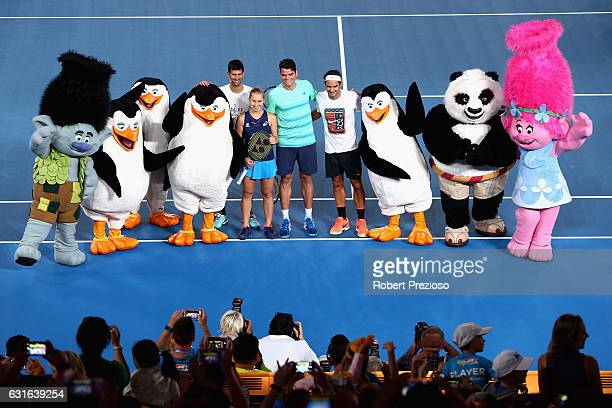Novak Djokovic of Serbia Daria Gavrilova of Australia Milos Raonic of Canada and Roger Federer of Switzerland pose with DreamWorks characters...