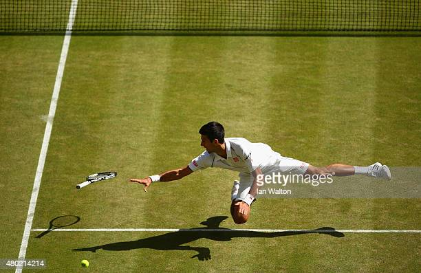 Novak Djokovic of Serbia dives for a backhand in the Gentlemens Singles Semi Final match against Richard Gasquet of France during day eleven of the...