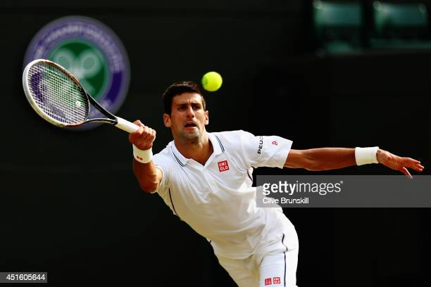 Novak Djokovic of Serbia during his Gentlemen's Singles quarterfinal match against Marin Cilic of Croatia on day nine of the Wimbledon Lawn Tennis...