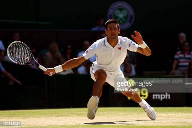Novak Djokovic of Serbia during his Gentlemen's Singles semifinal match against Grigor Dimitrov of Bulgaria on day eleven of the Wimbledon Lawn...