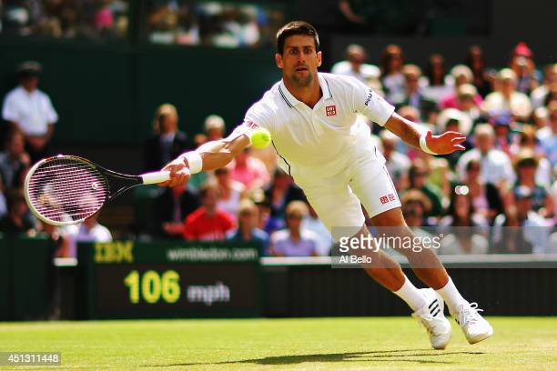 Novak Djokovic of Serbia during the fall in which he injures his shoulder making a return during his Gentlemen's Singles third round match against...