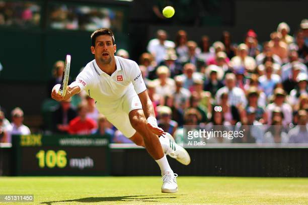 Novak Djokovic of Serbia during the fall in which he injurys his shoulder making a return during his Gentlemen's Singles third round match against...