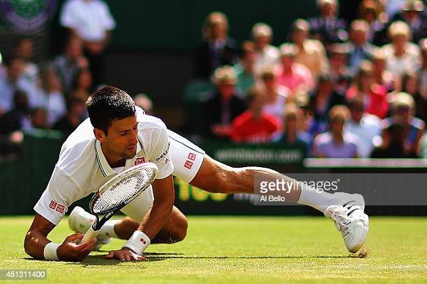 Novak Djokovic of Serbia during the fall which he injures his shoulder making a return during his Gentlemen's Singles third round match against...