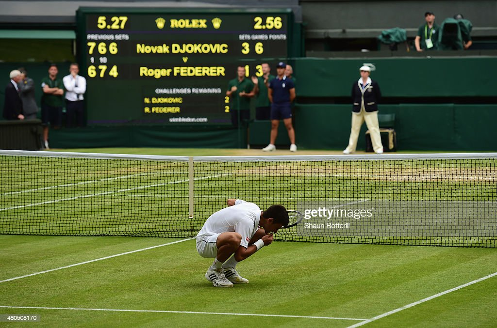 Novak Djokovic of Serbia eats the centre court grass after winning the Final Of The Gentlemen's Singles against Roger Federer of Switzerland on day thirteen of the Wimbledon Lawn Tennis Championships at the All England Lawn Tennis and Croquet Club on July 12, 2015 in London, England.