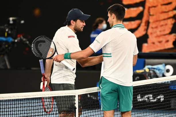 Novak Djokovic of Serbia embraces Aslan Karatsev of Russia following their Men's Singles Semifinals match during day 11 of the 2021 Australian Open...