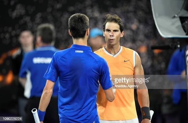 Novak Djokovic of Serbia embraces Rafael Nadal of Spain after winning championship in their Men's Singles Final match during day 14 of the 2019...