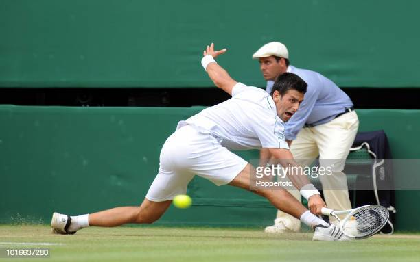 Novak Djokovic of Serbia enroute to losing his semifinal match against Tomas Berdych of the Czech Republic in straight sets on Day Eleven of the...