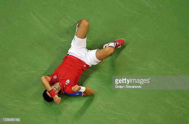 Novak Djokovic of Serbia falls after an injury during his Davis Cup semifinal match against Argentina's Juan Martin Del Potro at Belgrade Arena on...