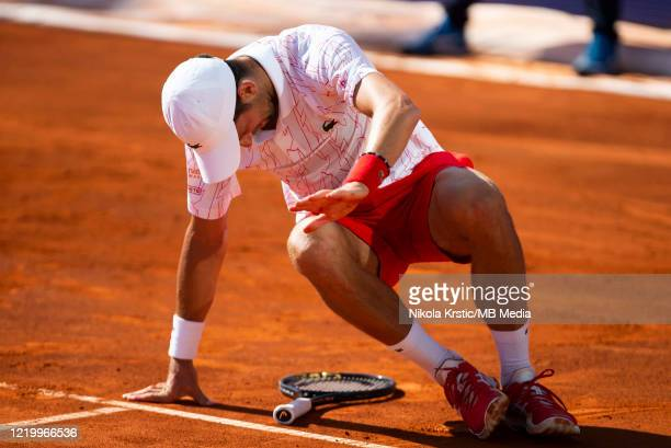 Novak Djokovic of Serbia falls after stumbling during his match against Alexander Zverev of Germany on June 14 during the 3rd day of Summer Adria...