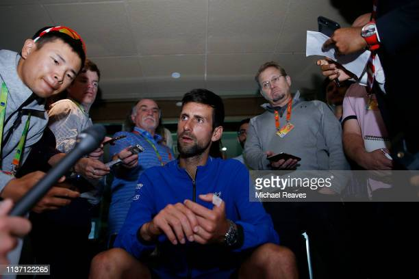 Novak Djokovic of Serbia fields questions from the media at a player availability session on Day 3 of the Miami Open Presented by Itau on March 20...
