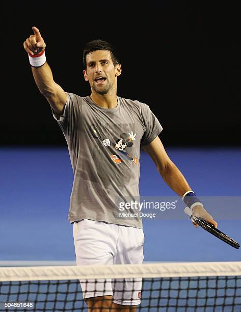Novak Djokovic of Serbia gestures to photographers during a practice session ahead of the 2016 Australian Open at Melbourne Park on January 14 2016...