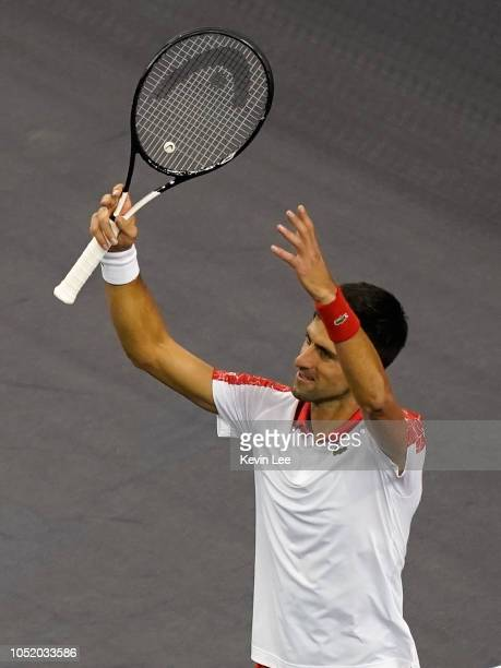 Novak Djokovic of Serbia gestures to spectators after defeating Alexander Zverev of Germany during the semifinal of men's singles match of the 2018...