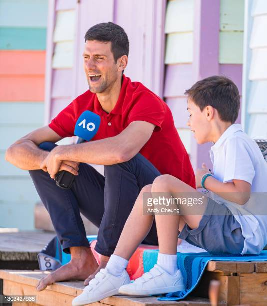 Novak Djokovic of Serbia greets a young tennis fan after winning the 2021 Australian Open Men's Final, at Brighton Beach on February 22, 2021 in...