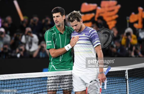 Novak Djokovic of Serbia greets his opponent at the end of the Men's Singles Final against Dominic Thiem of Austria on day fourteen of the 2020...