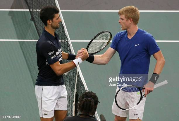 Novak Djokovic of Serbia greets Kyle Edmund of Great Britain after beating him in third round during day 4 of the Rolex Paris Masters 2019, an ATP...