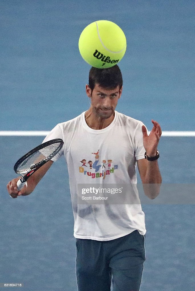 Novak Djokovic of Serbia heads an extra large tennis ball at the fifth annual Kids Tennis Day ahead of the 2017 Australian Open at Melbourne Park on January 14, 2017 in Melbourne, Australia.