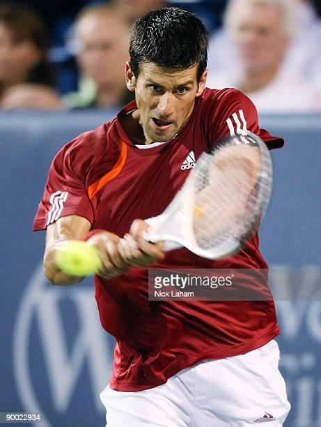 Novak Djokovic of Serbia hits a backhand against Rafael Nadal of Spain in their semi final during day six of the Western Southern Financial Group...