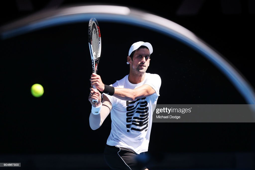 Novak Djokovic of Serbia hits a backhand during a practice session ahead of the 2018 Australian Open at Melbourne Park on January 14, 2018 in Melbourne, Australia.