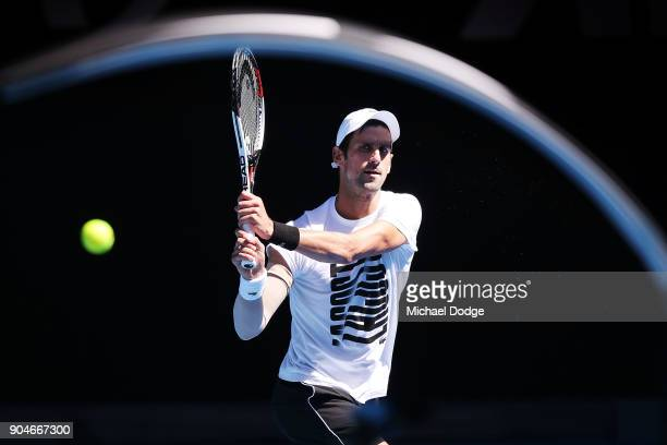 Novak Djokovic of Serbia hits a backhand during a practice session ahead of the 2018 Australian Open at Melbourne Park on January 14 2018 in...