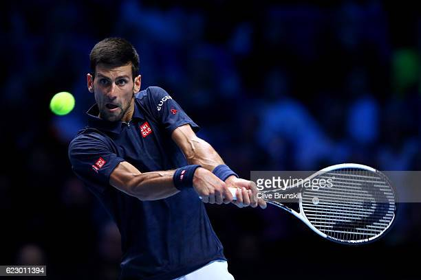 Novak Djokovic of Serbia hits a backhand during his men's singles match against Dominic Thiem of Austria on day one of the ATP World Tour Finals at...