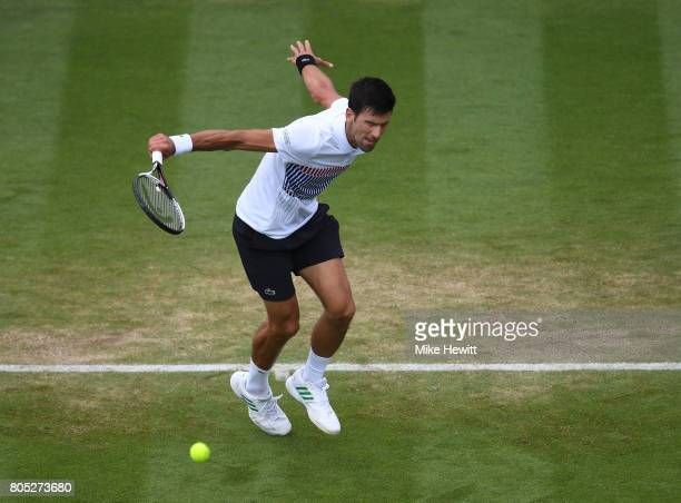Novak Djokovic of Serbia hits a backhand during his mens singles final against Gael Monfils of France on day seven of the Aegon International...