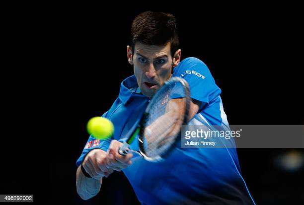 Novak Djokovic of Serbia hits a backhand during the men's singles final against Roger Federer of Switzerland on day eight of the Barclays ATP World...