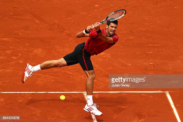 Novak Djokovic of Serbia hits a backhand during the Men's Singles second round match against Steve Darcis of Belgium on day five of the 2016 French...