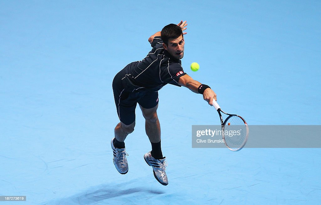 Novak Djokovic of Serbia hits a backhand in his men's singles match against Juan Martin Del Potro of Argentina during day four of the Barclays ATP World Tour Finals at O2 Arena on November 7, 2013 in London, England.