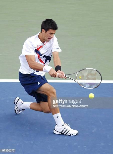 Novak Djokovic of Serbia hits a backhand return during his 2007 US Open men's final match against Roger Federer of Switzerland in Arthur Ashe Stadium...