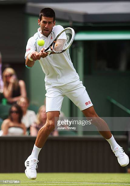 Novak Djokovic of Serbia hits a backhand return during his gentlemen's singles first round match against Juan Carlos Ferrero of Spain on day one of...