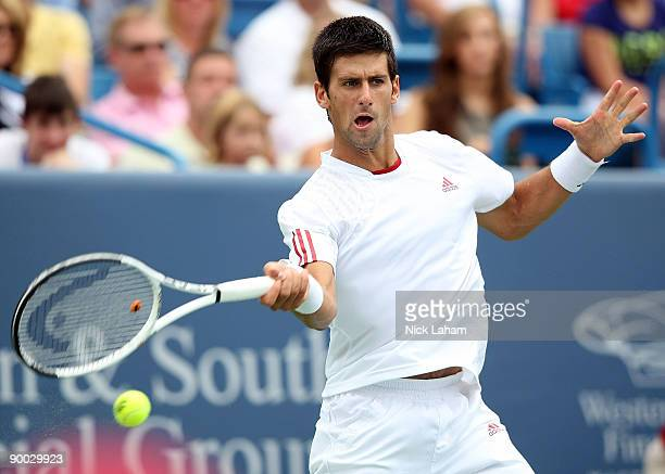 Novak Djokovic of Serbia hits a forehand against Roger Federer of Switzerland in the Singles Final during day seven of the Western Southern Financial...