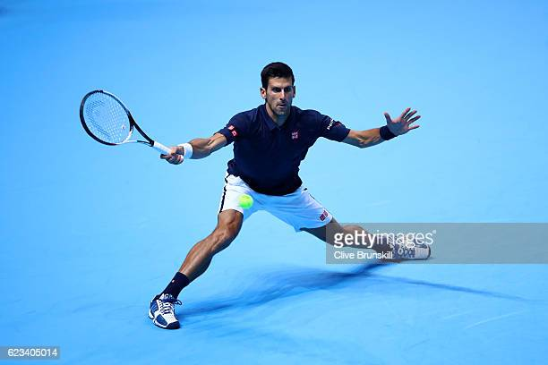 Novak Djokovic of Serbia hits a forehand during his men's singles match against Milos Raonic of Canada on day three of the ATP World Tour Finals at...