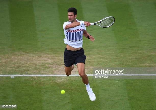 Novak Djokovic of Serbia hits a forehand during his mens singles final against Gael Monfils of France on day seven of the Aegon International...