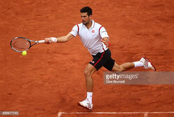 Novak Djokovic of Serbia hits a forehand during the Men's Singles fourth round match against Roberto Bautista Agut of Spain on day ten of the 2016...