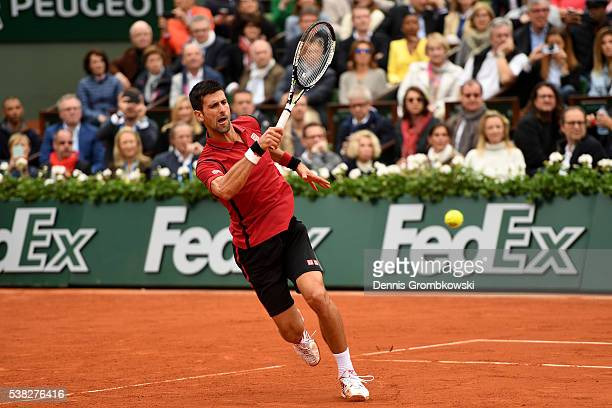 Novak Djokovic of Serbia hits a forehand during the Men's Singles final match against Andy Murray of Great Britain on day fifteen of the 2016 French...