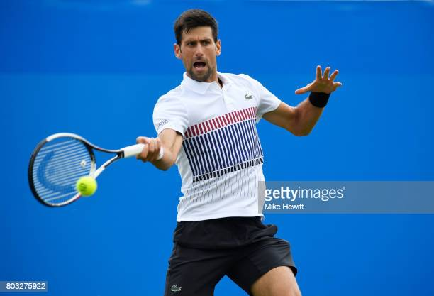Novak Djokovic of Serbia hits a forehand during the men's singles quarter final match against Donald Young of The United States on day five of the...