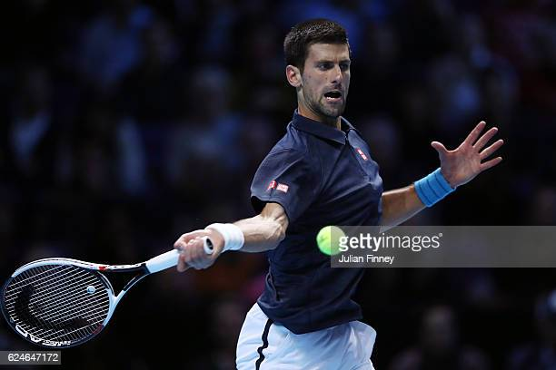 Novak Djokovic of Serbia hits a forehand during the Singles Final against Andy Murray of Great Britain at the O2 Arena on November 20 2016 in London...