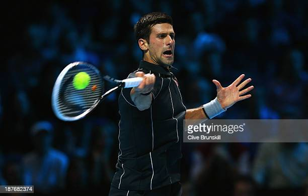 Novak Djokovic of Serbia hits a forehand in his men's singles final match against Rafael Nadal of Spain during day eight of the Barclays ATP World...