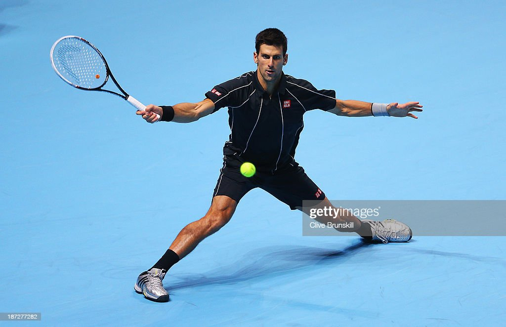 Novak Djokovic of Serbia hits a forehand in his men's singles match against Juan Martin Del Potro of Argentina during day four of the Barclays ATP World Tour Finals at O2 Arena on November 7, 2013 in London, England.