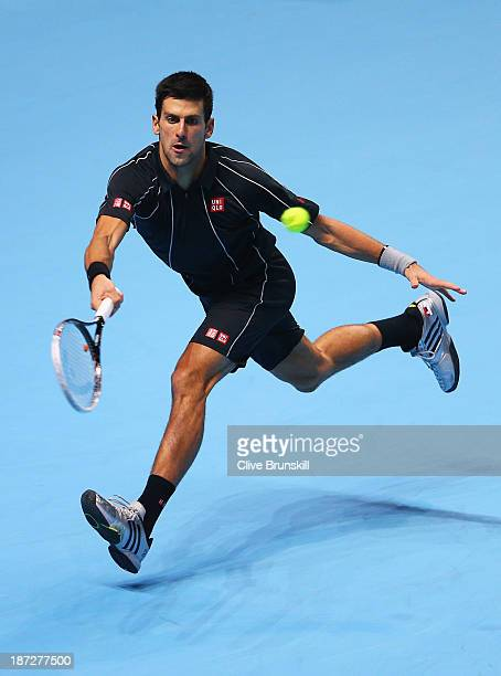 Novak Djokovic of Serbia hits a forehand in his men's singles match against Juan Martin Del Potro of Argentina during day four of the Barclays ATP...