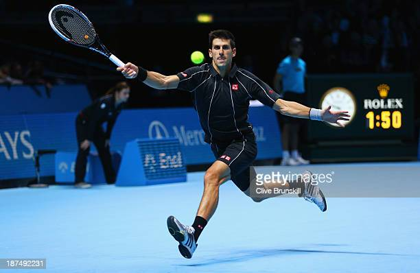 Novak Djokovic of Serbia hits a forehand in his men's singles match against Richard Gasquet of France during day six of the Barclays ATP World Tour...