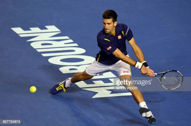 Novak Djokovic of Serbia hits a return against Andy Murray of Britain in their men's singles final match on day 14 of the 2016 Australian Open tennis...