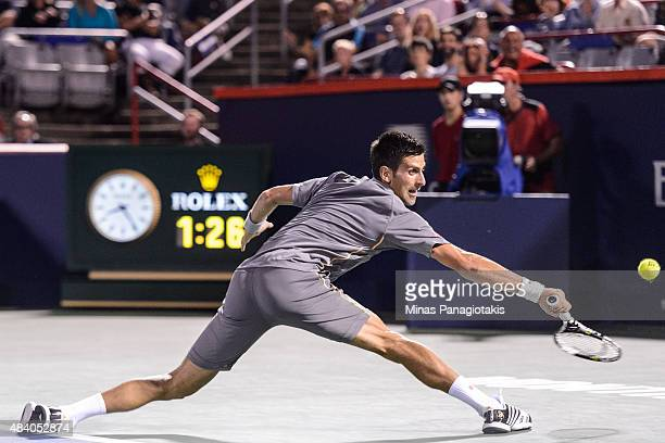 Novak Djokovic of Serbia hits a return against Ernests Gulbis of Latvia during day five of the Rogers Cup at Uniprix Stadium on August 14 2015 in...