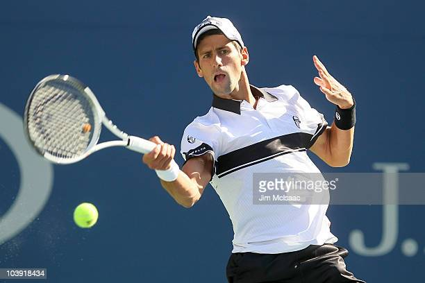 Novak Djokovic of Serbia hits a return against Gael Monfils of France during his men's singles quarterfinal match on day ten of the 2010 US Open at...