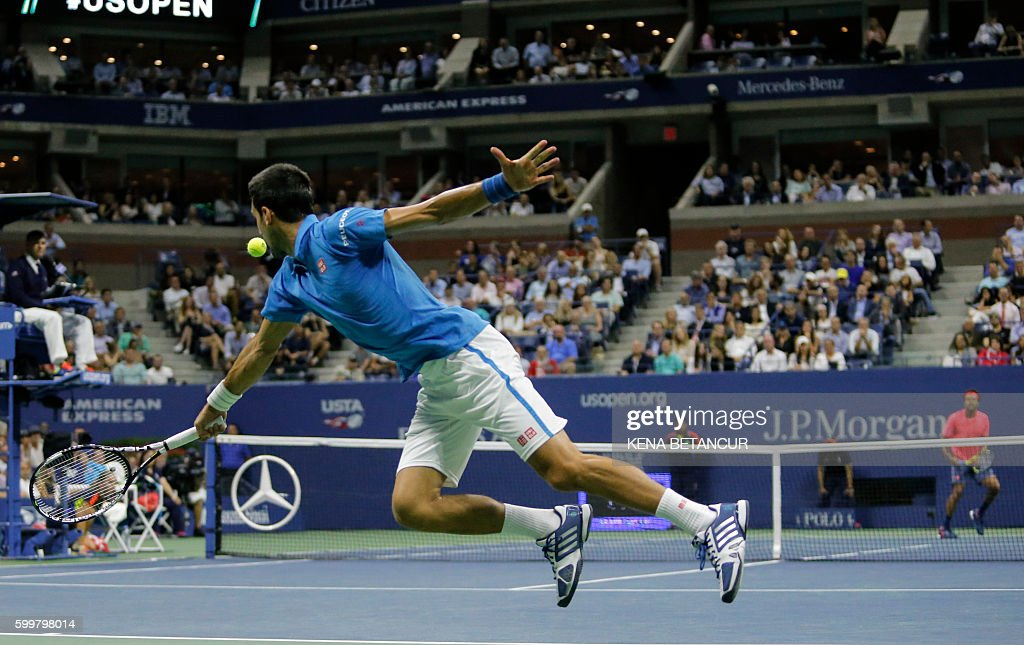 TOPSHOT - Novak Djokovic of Serbia hits a return against Jo-Wilfried Tsonga of France during their 2016 US Open Men's Singles match at the USTA Billie Jean King National Tennis Center in New York on September 6, 2016. / AFP / KENA