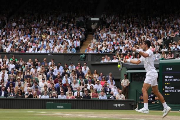 Novak Djokovic of Serbia hits a return during the men's final match between Novak Djokovic of Serbia and Matteo Berrettini of Italy at Wimbledon...