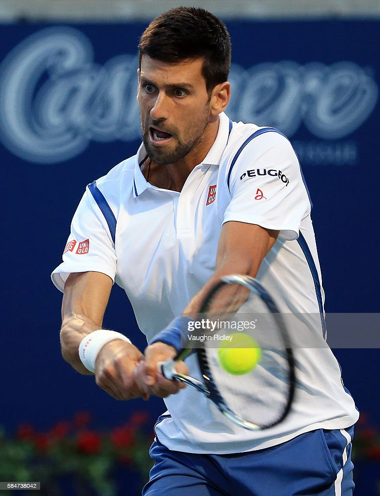 Novak Djokovic of Serbia hits a shot against Gael Monfils of France during Day 6 of the Rogers Cup at the Aviva Centre on July 30, 2016 in Toronto, Ontario, Canada.