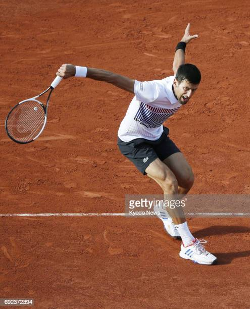 Novak Djokovic of Serbia hits a slice backhand during a French Open fourthround match against Albert RamosVinolas of Spain in Paris on June 4 2017...