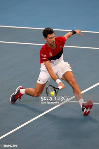 Novak Djokovic of Serbia hits a volley during day nine of the semi-final singles match at the 2020 ATP Cup Tennis at Ken Rosewall Arena on January...